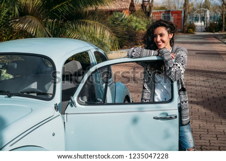Brunette woman next to the old car #1235047228