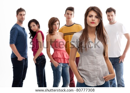 brunette woman standing in front of group of casual people
