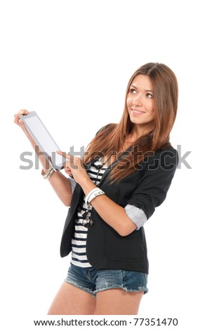 Brunette woman typing on her new electronic tablet touch pad computer pc one finger touches the digital screen isolated on a white background