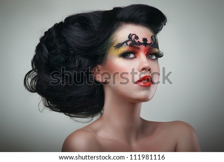 Brunette woman with beautiful hairstyle and makeup