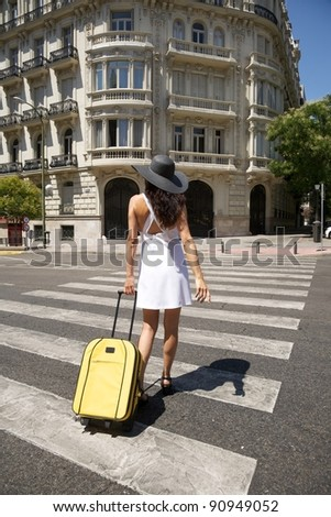 brunette woman with white dress walking in Madrid city Spain