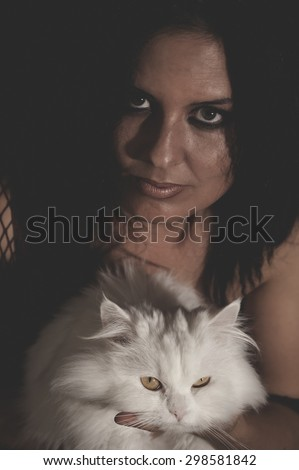 brunette woman with white Persian cat with long hair
