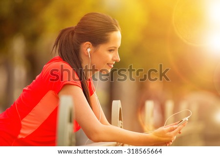 Brunette young woman listening to music.