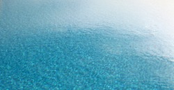Brur Sky Reflection in water surface. Blue pool horizontal background.