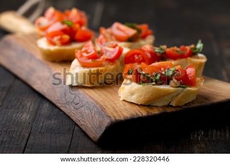 bruschetta set on vintage wooden board
