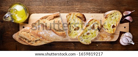 Bruschetta. Toasted bread with garlic and extra virgin olive oil, top view. Stock fotó ©
