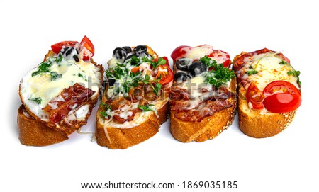 Bruschetta with different fillings on a white background. Vegetables, meat and cheese bruschetta. High quality photo Stock fotó ©