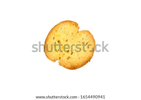 Bruschette chips, single dry slice of baked bread, beer snack isolated on wooden background, top view