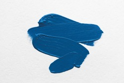 brush and paint texture on paper blue color. color the year 2020 pantone classic blue