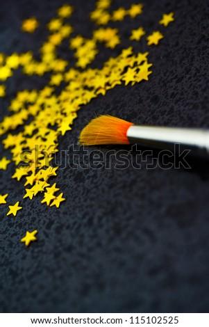 brush creating stars on black: uniqueness, talent - stock photo