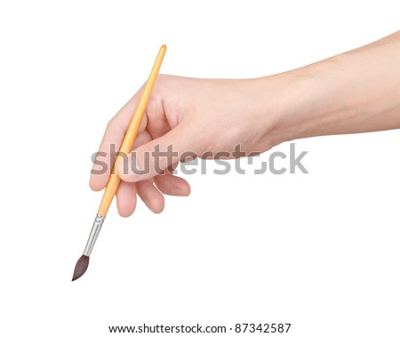Brush in hand on white background