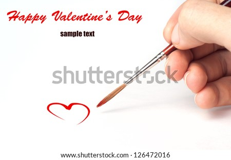 Brush in the arm draws the heart. Valentine's day art isolated on white background