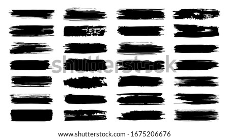 Brush paint strokes. Texture brushes and modern grunge brush lines. Ink brush artistic design element for frame design.  isolated elements set. Grungy black swatches. Rough smears and stains