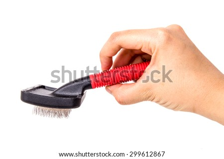 Brush, Pet Grooming Brush, Wire Comb for Dog, Cat, Rabbit or Others Pet. Hand Holding to Used with Hair, Fur. Isolated on White Background.