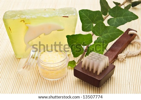 brush soap and sea-salt arrangement on bamboo board