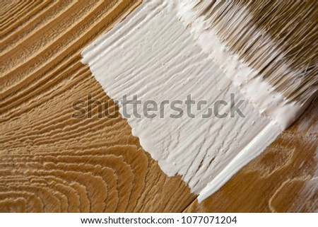 Brush stains white pine boards. staining concept #1077071204