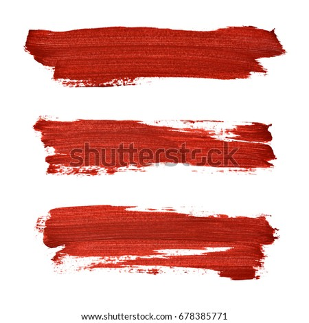 Brush strokes of red acrylic paint isolated on the white background