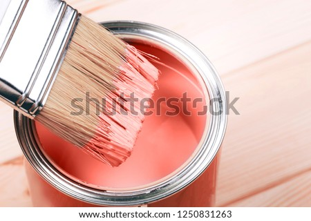 Brush with Living Coral paint on wooden background. Color of the year 2019. Main trend concept. Foto d'archivio ©