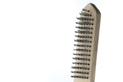 Brush with metal pile for brushing wood. Hand tool