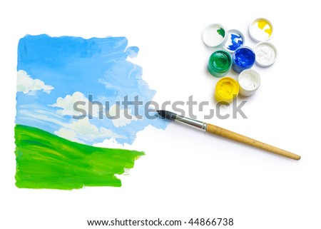 Brush with paint and hand made image on white background
