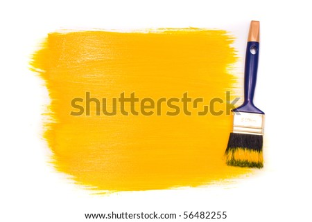 Brush with yellow paint on the white background