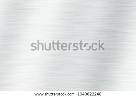 Brushed light  metal texture. Polished metal texture background with light reflection.