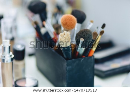 brushes, accessories and accessories for make-up on table