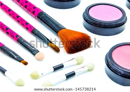 Brushes and cosmetic on a white background