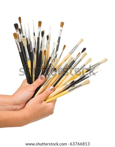 Brushes in hand isolated on white background
