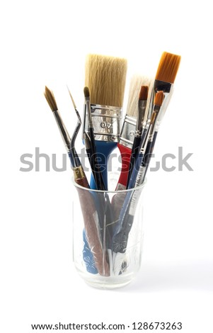 brushes in jar on white background