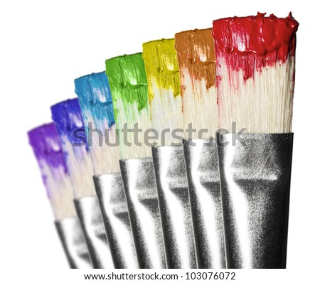 Brushes in rainbow color paint in white background