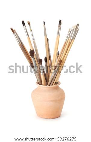 brushes in vase
