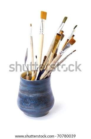 brushes in vase