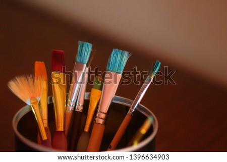 brushes of various colors and various shapes