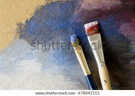 Brushes on the background of a blank canvas to draw on canvas, palette, the artist's Studio