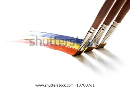 Brushes painting rainbow on white