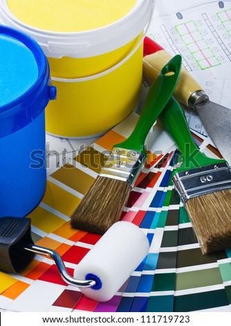 brushes, rollers of paint rooms on the architectural plan