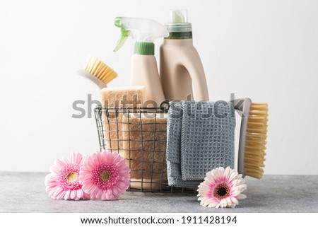 Brushes, sponges, cleaning cloth  and natural cleaning products in the basket.  Eco-friendly cleaning products. Spring freshness and purity concept