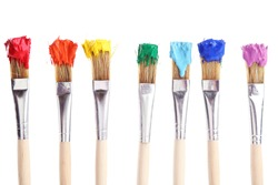 Brushes with colorful paints, isolated on white