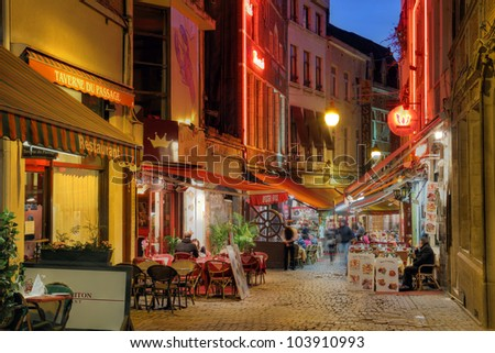 BRUSSELS - APRIL 22: Restaurants along the Rue de Bouchers in Brussels, Belgium on April 22, 2012. The ancient medieval street is renown for the many places to quench one's hunger.