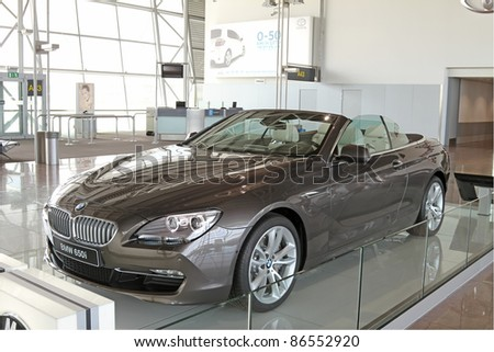 BRUSSELS-AUGUST 11: The new BMW 650i on display, for advertising and marketing reasons, on August 11, 2011 in the airport of Brussels, Belgium. A crowded airport is a good place for advertising.