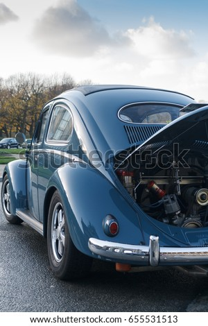 BRUSSELS, BELGIUM - DECEMBER 1, 2013: Retro car Volkswagen Beetle Oval Type 1 with opened hood parked at the Cinquantenaire park during vintage car expo.  #655531513