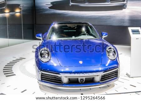 Brussels, Belgium, Jan 18, 2019: metallic blue all new Porsche 911 Carrera S eighth-generation at Brussels Motor Show, supersport car built by Porsche