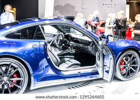 Brussels, Belgium, Jan 18, 2019: metallic blue all new Porsche 911 Carrera S eighth-generation at Brussels Motor Show, supersport car built by Porsche #1295264605