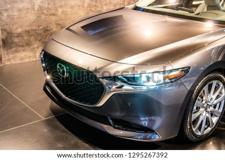 Brussels, Belgium, Jan 18, 2019: metallic graphite silver all new Mazda 3 Fourth generation at Brussels Motor Show, compact car manufactured in Japan by Mazda #1295267392