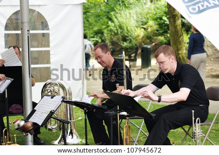 BRUSSELS, BELGIUM - JULY, 21: Military orchestra musicians preparing for a concert in Parc de Bruxelles during National Day of Belgium celebrations on July 21, 2009 in Brussels.