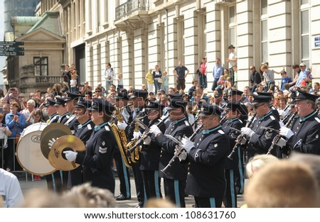 BRUSSELS, BELGIUM - JULY, 21: Military orchestra participates in defile during National Day of Belgium celebrations on July 21, 2012 in Brussels, Belgium.