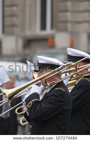 BRUSSELS, BELGIUM - JULY, 21: Navy orchestra takes part in yearly military parade during National Day of Belgium on July 21, 2009 in Brussels.