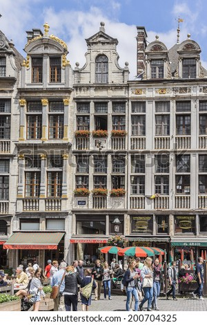 BRUSSELS, BELGIUM - JUNE 19, 2014: Houses of the famous Grand Place (Grote Markt) - the central square of Brussels. Grand Place was named by UNESCO as a World Heritage Site in 1998.