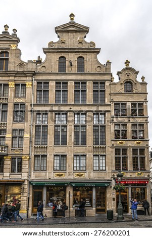 BRUSSELS, BELGIUM - MAY 11, 2014: Houses of the famous Grand Place (Grote Markt) - the central square of Brussels. Grand Place was named by UNESCO as a World Heritage Site in 1998.